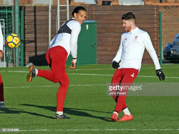 LIVERPOOL ENGLAND FEBRUARY 20 Virgil van Dijk with Alberto Moreno of Liverpool during a training session at Melwood Training Ground on February 20...