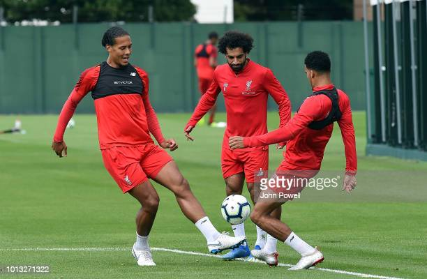 Virgil van Dijk with Mohamed Salah and Dominic Solanke of Liverpool during a training session at Melwood Training Ground on August 8 2018 in...