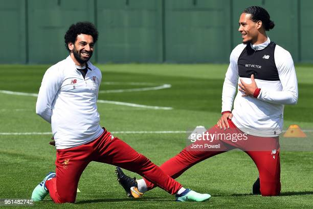Virgil van Dijk with Mohamed Salah of Liverpool during a training session at Melwood on April 26 2018 in Liverpool England