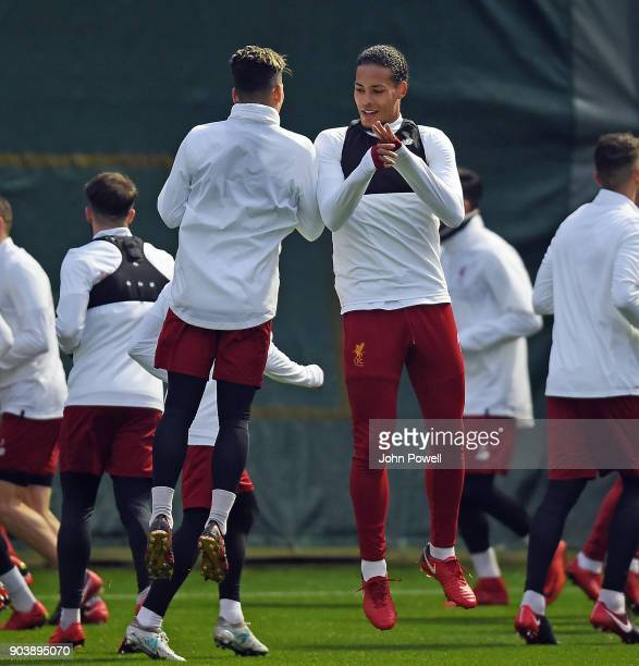 Virgil van Dijk with Roberto Firmino of Liverpool during a training session at Melwood Training Ground on January 11 2018 in Liverpool England