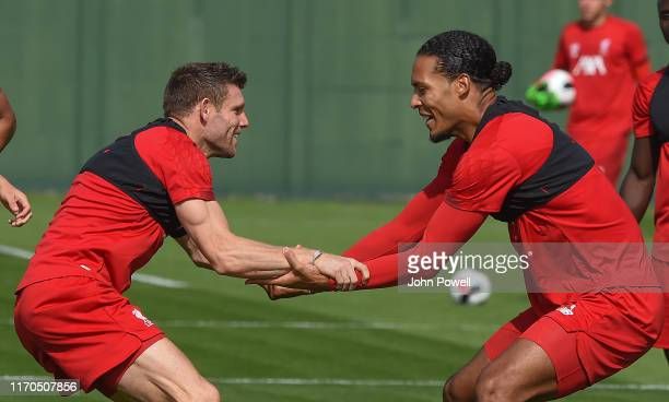 Virgil vanDijk with James Milner of Liverpool during a training session at Melwood Training Ground on August 27 2019 in Liverpool England