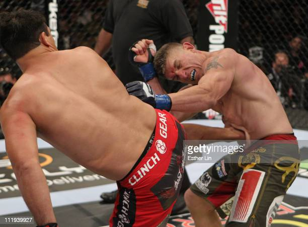 Virgil Zwicker kicks Brett Albee during a heavyweight bout at the Strikeforce event at the Valley View Casino Center on April 9, 2011 in San Diego,...