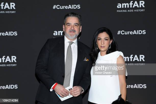 Virgilio Garza and Gaby Lobo pose during the amfAR gala dinner at the house of collector and museum patron Eugenio López on February 5 2019 in Mexico...