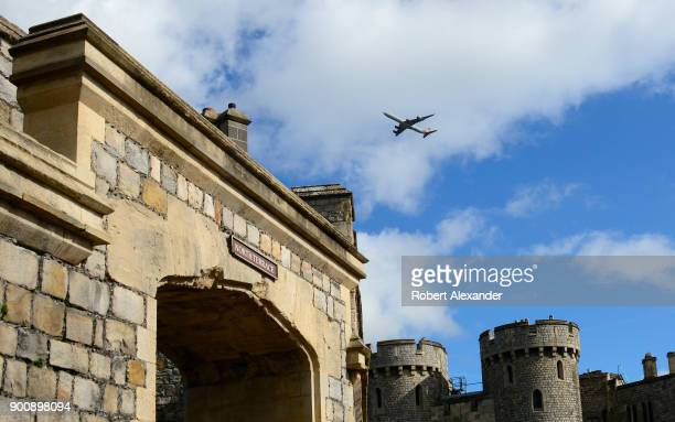 Virgin Airways passenger jet flies high over Windsor Castle in Windsor England Windsor Castle is a residence of the British royal family Since the...