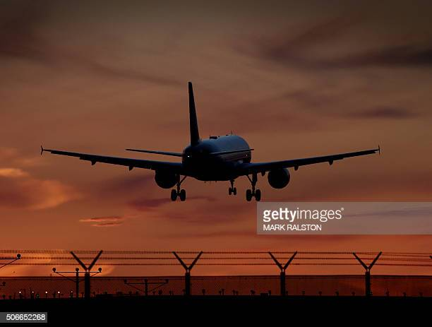 A Virgin America plane makes its descent over the city of Inglewood as it prepares to land at Los Angeles International Airport California on January...