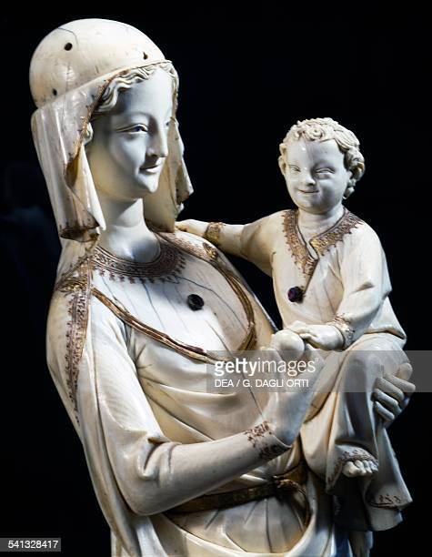 Virgin and Child prior to 1279 ivory statue from SainteChapelle in Paris France 13th century Paris Musée Du Louvre