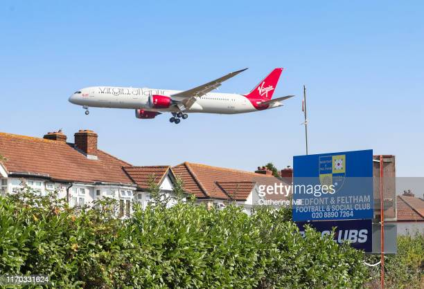Virgin Atlantic aeroplane comes in to land at Heathrow Airport during the Cherry Red Records Combined Counties Football League Division One match...