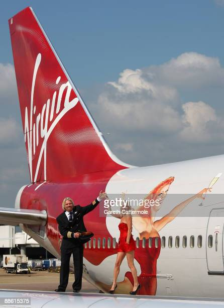 Virgin Atlantic boss Richard Branson poses with model Kate Moss on a wing of a jumbo jet at Heathrow Airport on June 22 2009 in London England Today...