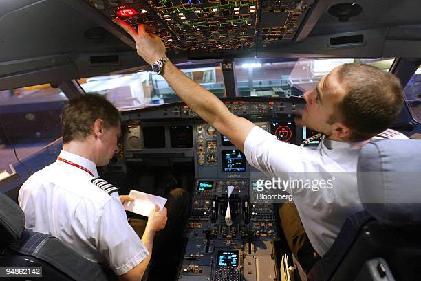 Virgin Atlantic Captain David Tilton and copilot Paul Howe do a preflight check in the cockpit of an Airbus A34400 before the aircraft pushes back...