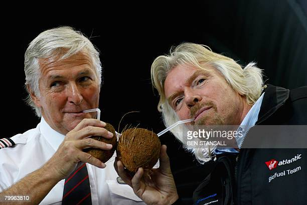 Virgin Atlantic chief Richard Branson poses with a coconut in front of a Virgin Atlantic Boeing 747 with pilot Captain Geoff Andreasen before the...