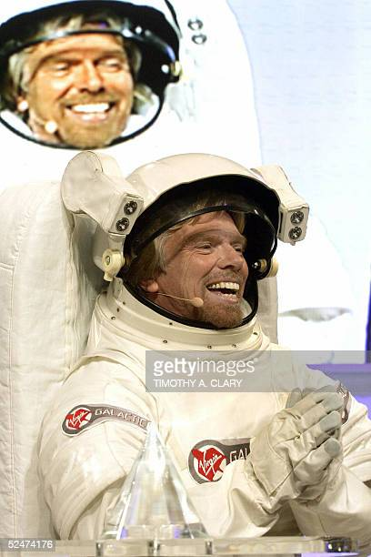 Virgin Atlantic Founder Richard Branson wearing a spacesuit announces the winner of his Virgin Galatic SubOrbital flight during a press conference...