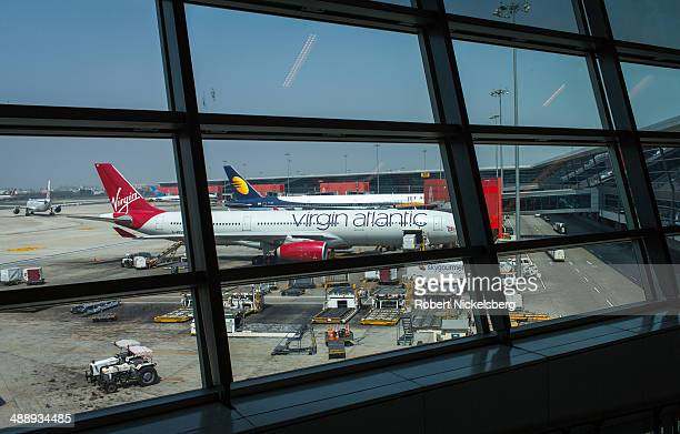Virgin Atlantic plane is prepared for departure March 9 2014 by a ground crew at Indira Gandhi International Airport in New Delhi India