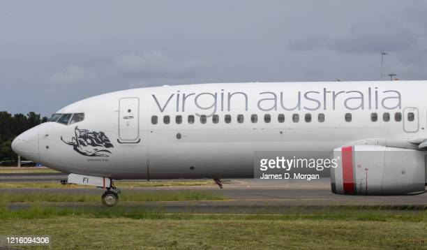 Virgin Australia Boeing 737-800 series aircraft on the runway at Sydney's main international airport, Kingsford Smith, on March 15, 2020 in Sydney,...