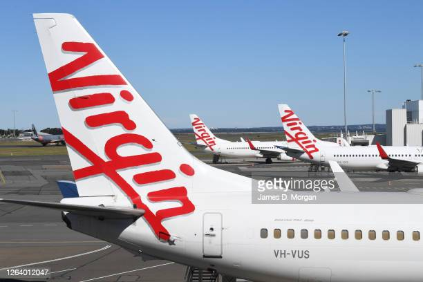 Virgin Australia Boeing 737's sit empty on the tarmac at Sydney Airport on August 05, 2020 in Sydney, Australia. Virgin Australia has announced 3000...