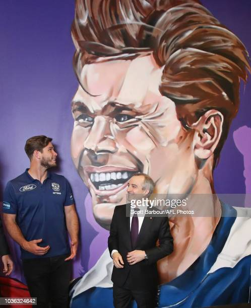 Chief Executive Officer Gillon McLachlan and Virgin Australia CEO and Managing Director John Borghetti along with Tom Hawkins of the Cats unveil the...