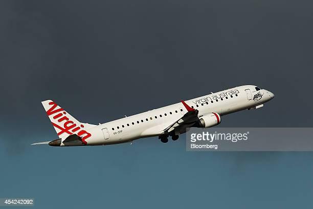 A Virgin Australia Holdings Ltd aircraft takes off at Sydney Airport in Sydney Australia on Wednesday Aug 27 2014 Virgin Australia the nation's...