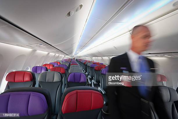 A Virgin Australia Holdings Ltd employee walks through the interior of one of the company's Boeing 737800 aircraft at the domestic terminal of Sydney...