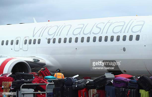 Virgin Australia plane is seen at a gate at Gold Coast Airport on July 9 2015 in Gold Coast Australia All Virgin Australia flights to Bali have been...