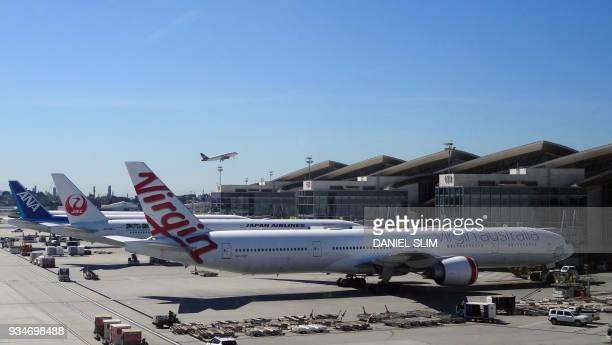 A Virgin Australia plane parks at the gate at Los Angeles International Airport on March 5 2018 / AFP PHOTO / Daniel SLIM