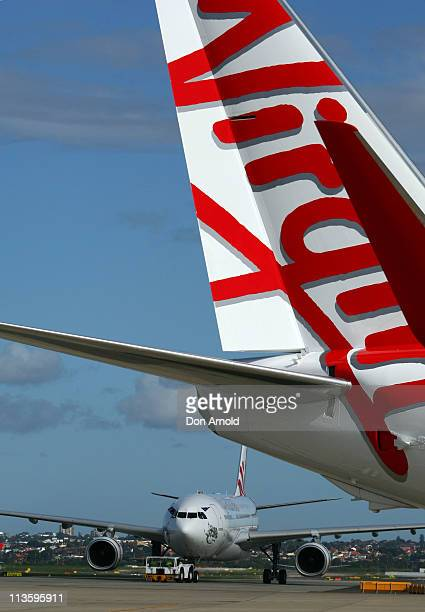 Virgin Australia's A330 and Boeing 737 airplanes are seen during a rebranding launch which saw Virgin Australia replace Virgin Blue and V Australia...