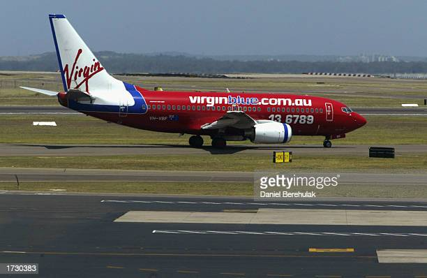 Virgin Blue 737 aircraft taxis down the runway at the Kingsford Smith International Airport on January 17 2003 in Sydney Australia Boeing today...