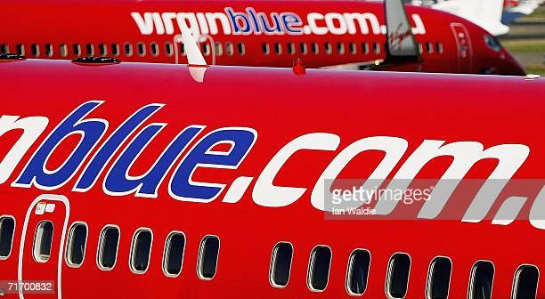 Virgin Blue aircraft wait at Sydney's Mascot airport August 23 2006 in Sydney Australia Virgin Blue today announced that its net profit for the nine...
