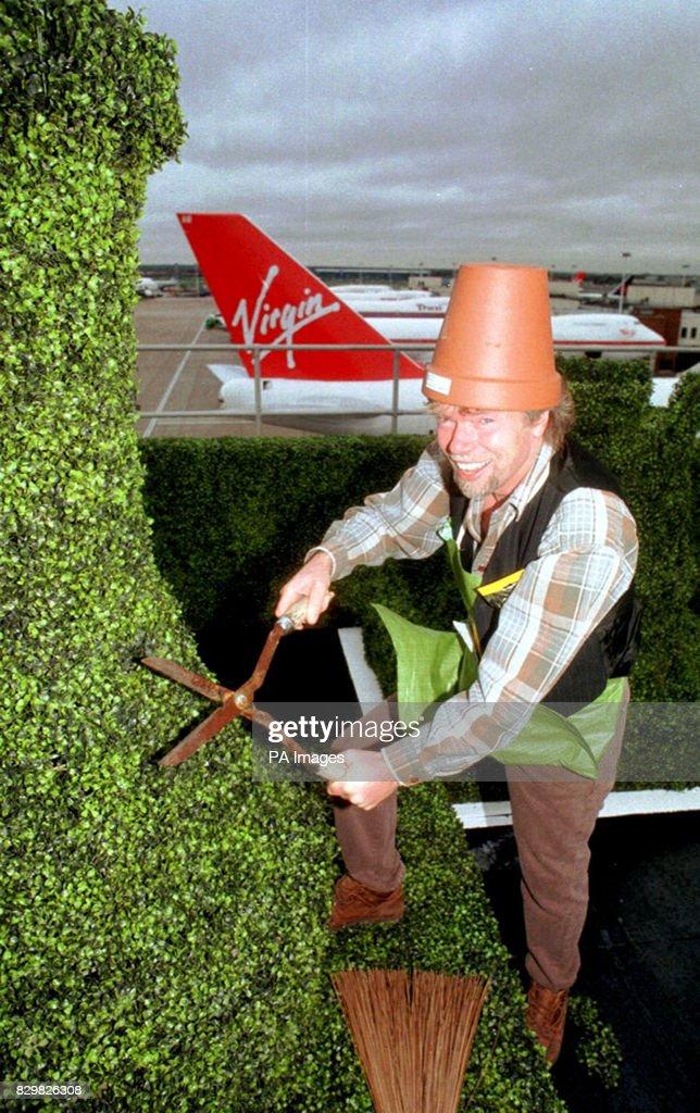14.11.94: Virgin boss Richard Branson potters around his new roof ...