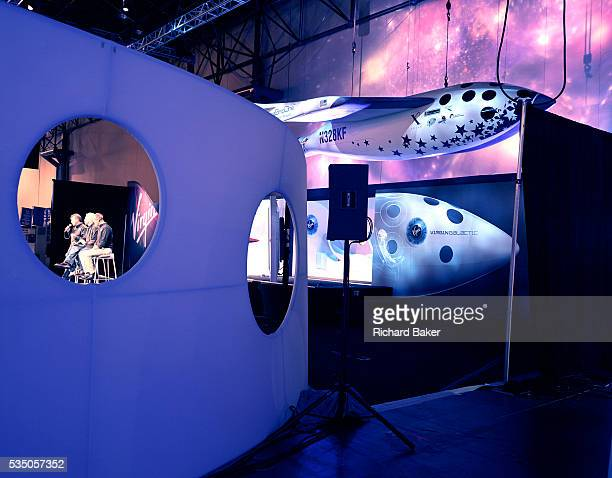 Virgin boss Sir Richard Branson and Virgin Galactic directors Will Whitehorn and Stephen Attenborough talk to the media during the unveiling of their...