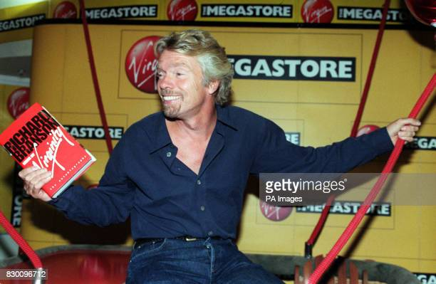 Virgin Boss/adventurer Richard Branson sits in a balloon basket at Virgin Megastore in London today , where he signed copies of his new book, Losing...