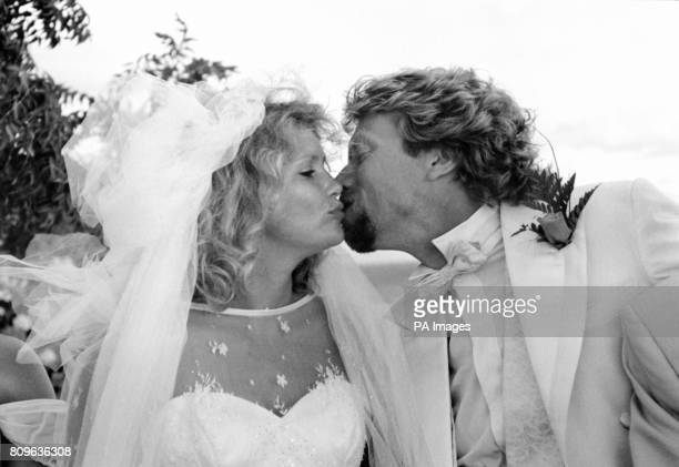 Virgin chairman Richard Branson kisses his bride, partner of 14 years, Joan Templeman at their wedding on Necker Island in the Caribbean sea