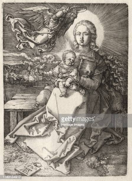 Virgin Crowned by an Angel 1520 The boundary between heaven and earth is obscured in this engraving as an angel descends to crown the Virgin with a...