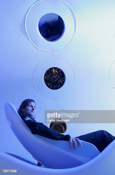 Virgin employee sits in the cabin of a prototype Virgin Galactic SpaceShipTwo spacecraft at the Science Museum on February 14 2007 in London England...