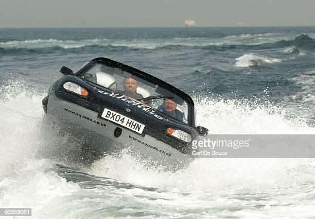 Virgin entrepreneur Richard Branson pilots his Gibbs Aquada amphibious car during a recordbreaking crossing of the English Channel June 14 2004...