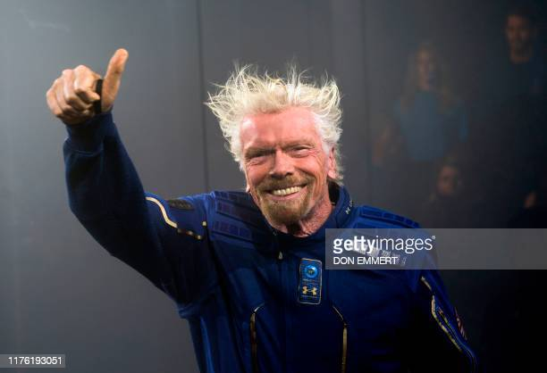 Virgin Galactic Founder Sir Richard Branson demonstrates a spacewear system, designed for Virgin Galactic astronauts, at an event October 16, 2019 in...