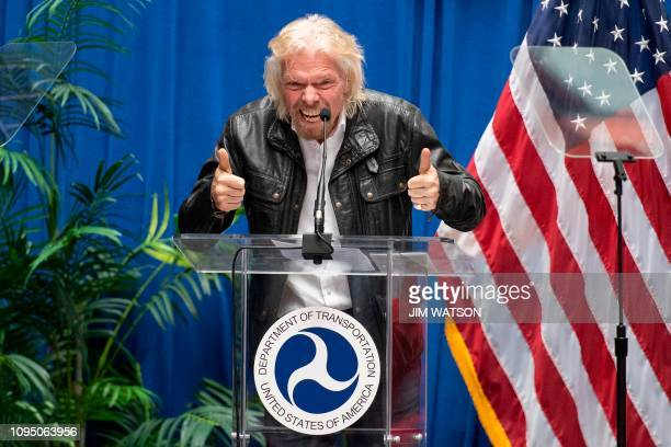 """Virgin Galactic founder Sir Richard Branson speaks during a ceremony to award test pilots Mark """"Forger"""" Stucky and Frederick """"CJ"""" Sturckow their FAA..."""