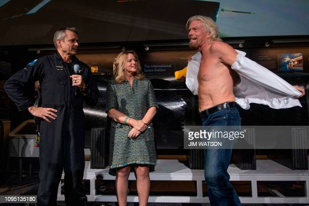 Virgin Galactic founder Sir Richard Branson takes off his shirt to don a tshirt that says Future Astronaut Training Program that was given to him by...