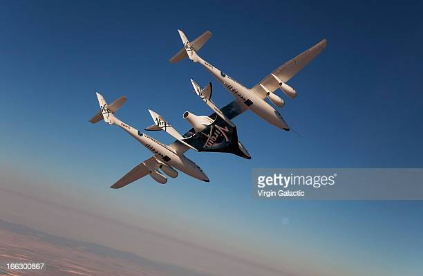 Virgin Galactic vehicles WhiteKnightTwo and SpaceShipTwo in flight during captive carry test flight at Mojave on July 15 2010 in California