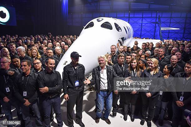 Virgin Galactic's Richard Branson front center gathers with Virgin Galactic employees in front of the new SpaceShip Two VSS Unity after a rollout...