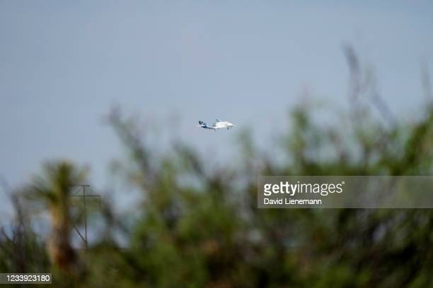 Virgin Galactic's VSS Unity returns to Spaceport America after its first fully crewed test flight July 11, 2021 in Truth Or Consequences, New Mexico....
