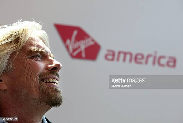 Virgin Group chairman Sir Richard Branson speaks to a crowd after he arrived at San Francisco International Airport on Virgin America's first flight...