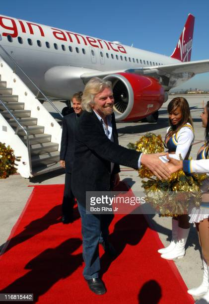 Virgin Group founder and chairman Sir Richard Branson is welcomed by San Diego Chargers Cheerleaders upon arrival in San Diego Ca after the 'first...