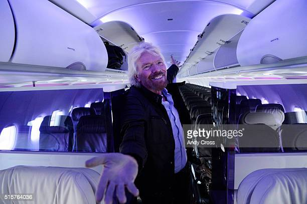 Virgin Group Founder Richard Branson stands inside a new Airbus A320 Virgin America airplane at Denver International Airport sfter the inaugural...
