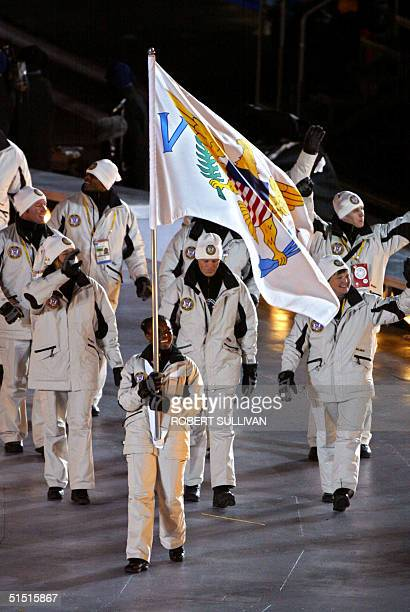 Virgin Islands delegation arrives 08 February 2002 for the opening ceremonies of the 2002 Winter Olympics at the Rice Eccles Stadium in Salt Lake...