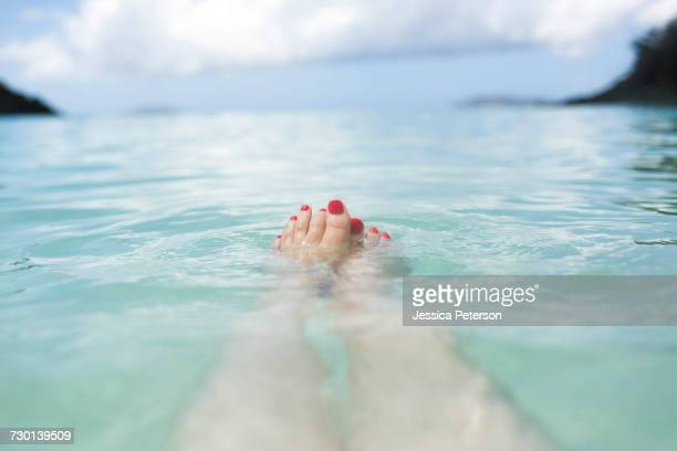 USA, Virgin Islands, Saint Thomas, Female feet in sea