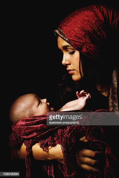 virgin mary baby jesus christ born christmas - manger stock photos and pictures