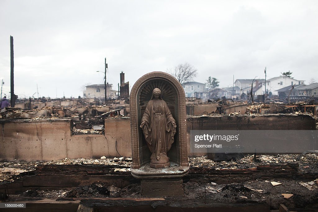 A Virgin Mary is all that remains from a home which was destroyed during Hurricane Sandy in Breezy Point, Queens on October 30, 2012 in New York, United States. Over 50 homes wer destroyed in a late night and fast moving fire. At least 15 people were reported killed in the United States by Sandy as millions of people in the eastern United States have awoken to widespread power outages, flooded homes and downed trees. New York City was hit especially hard with wide spread power outages and significant flooding in parts of the city.