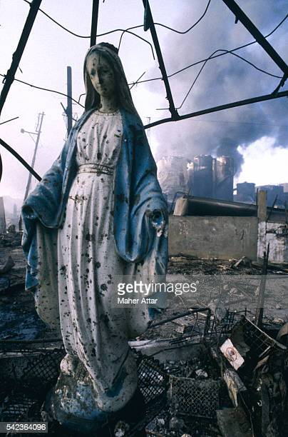 A Virgin Mary statue near propane tanks that have exploded during the Lebanon War | Location Dora Beirut Lebanon