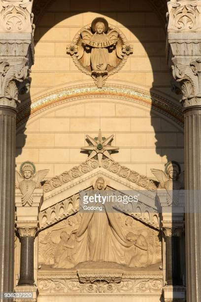 Virgin Mary with Adam and Eve Eardrum Arcatures of the porch Basilica of NotreDame de Fourvi�re Lyon