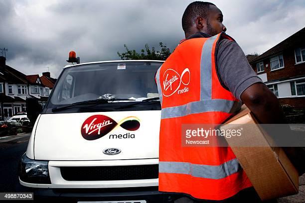 A Virgin Media employee delivering a digital tv reciever