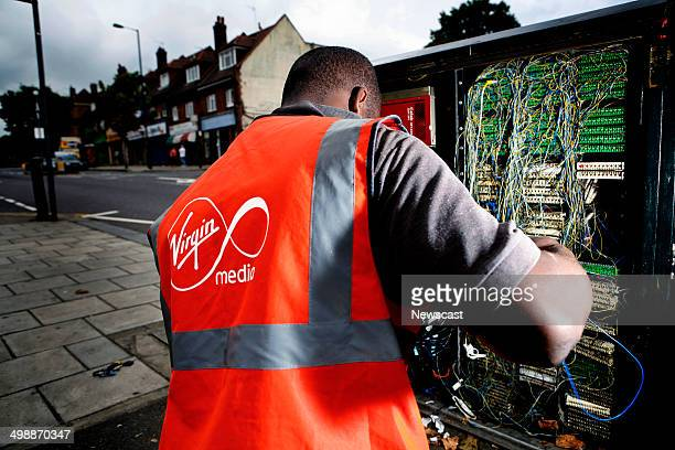 A Virgin Media engineer connecting a house to the Virgin telephone internet and cable television network in North London